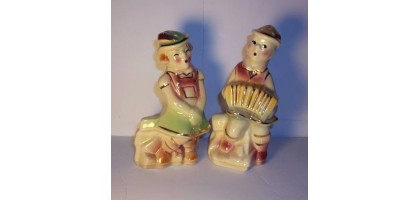 VINTAGE SHAWNEE SWISS BOY AND GIRL SALT AND PEPPER SHAKERS WITH GOLD TRIM