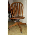 Solid oak desk chair or Office Winsor back with wheels and ajustable